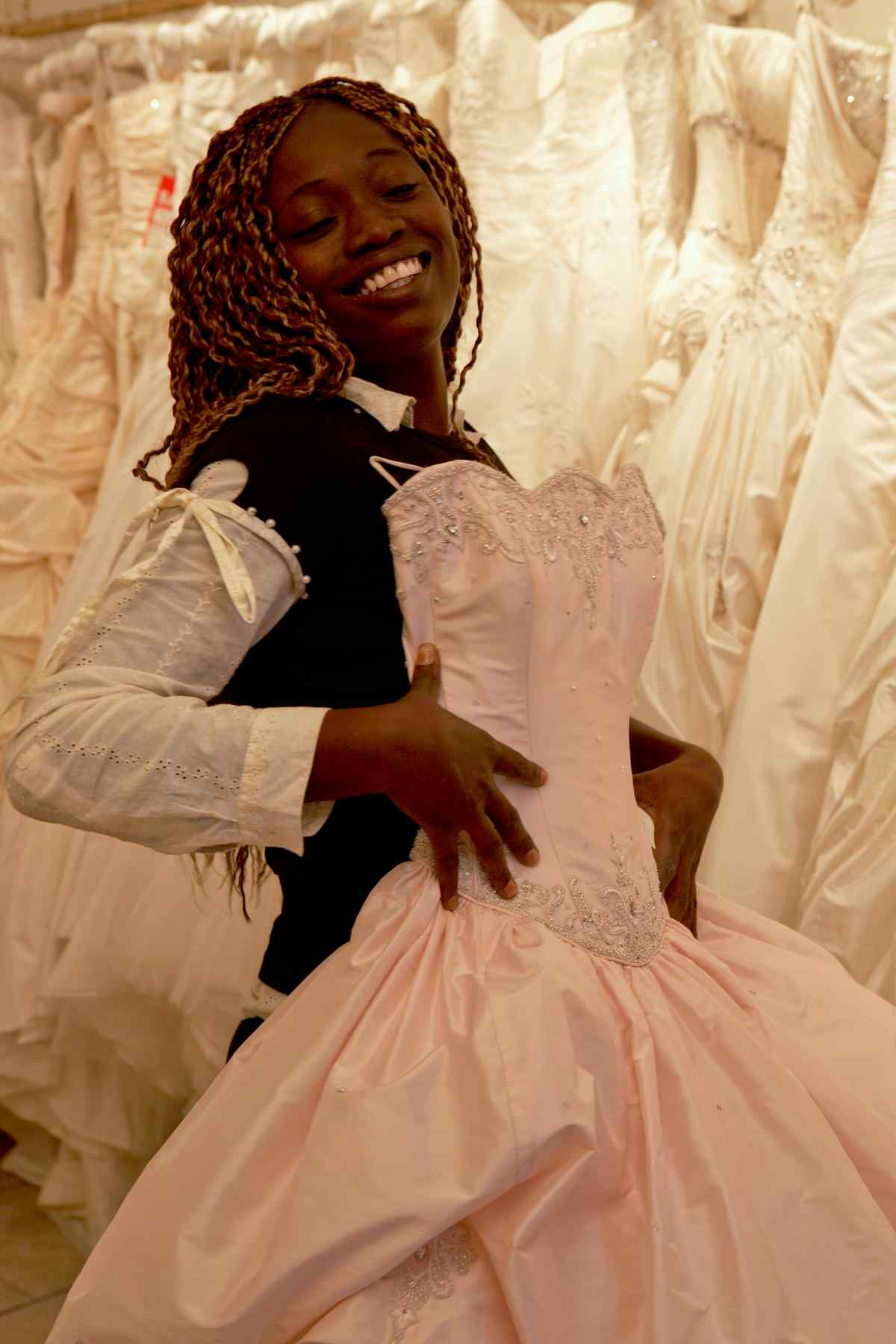 Francess N. Smart poses in a wedding dress shop during a lucky visit to the UK